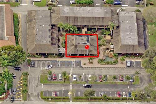 Photo of 3000 N University Dr #1A, Coral Springs, FL 33065 (MLS # A10775910)