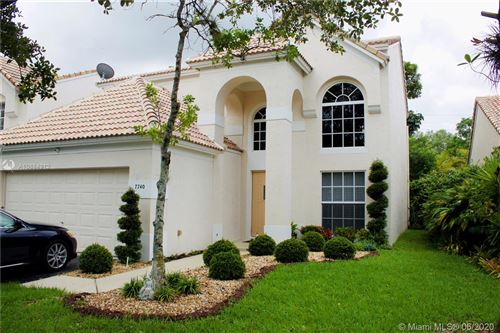 Photo of 7740 Hibiscus Ln #7740, Coral Springs, FL 33065 (MLS # A10884912)