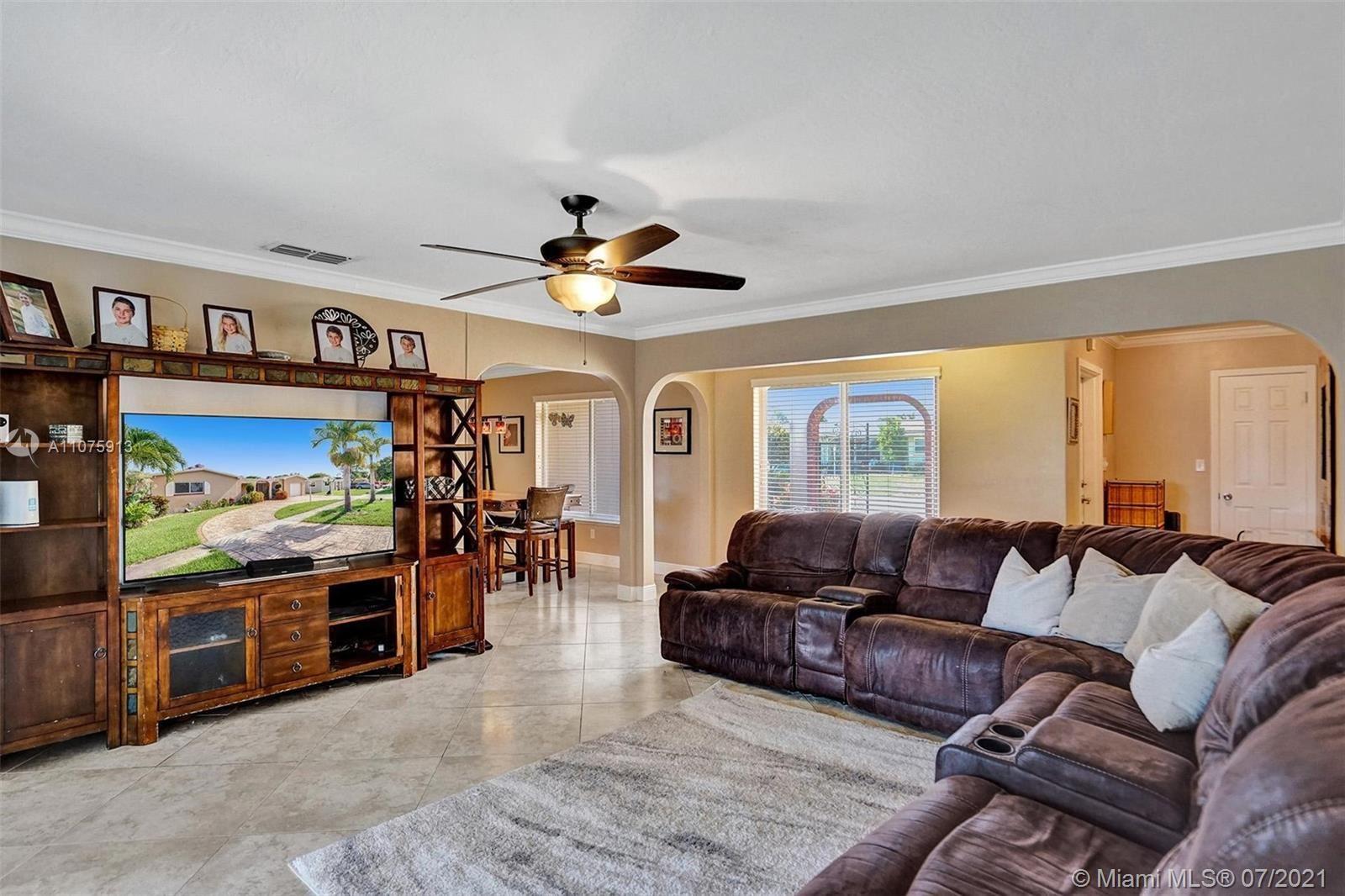 Photo of 8450 NW 19th St, Pembroke Pines, FL 33024 (MLS # A11075913)