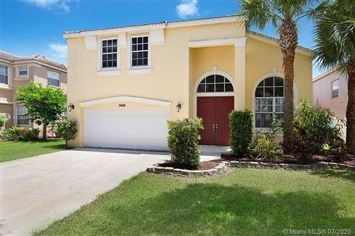 Photo of 2469 Westmont Ln, Royal Palm Beach, FL 33411 (MLS # A10888914)