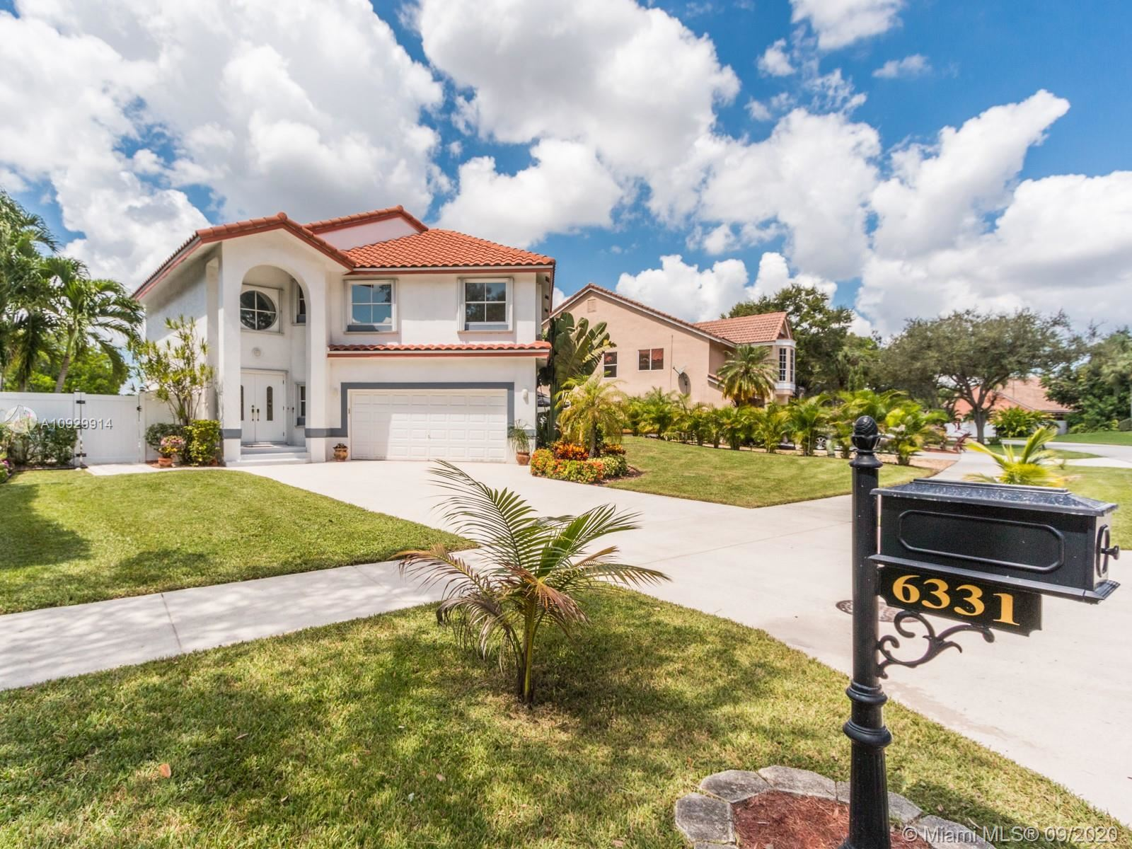 Photo of 6331 NW 57th Way, Parkland, FL 33067 (MLS # A10929914)