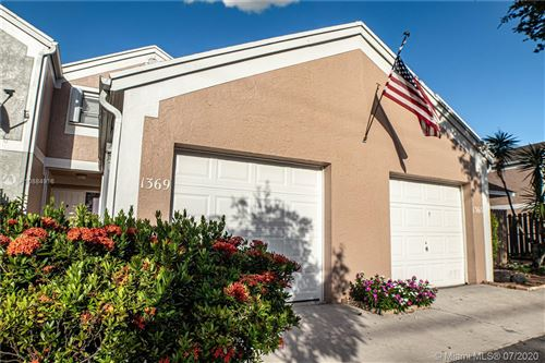 Photo of 1369 NW 124th Ave, Pembroke Pines, FL 33026 (MLS # A10884916)