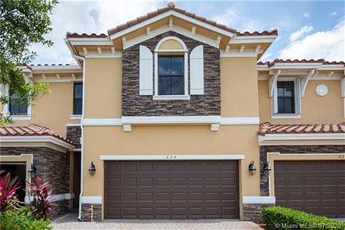 Photo of 824 W Village Circle, Davie, FL 33325 (MLS # A10890916)