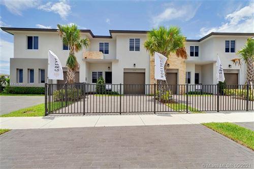 Photo of 1641 Pioneer Way, Royal Palm Beach, FL 33411 (MLS # A11017920)
