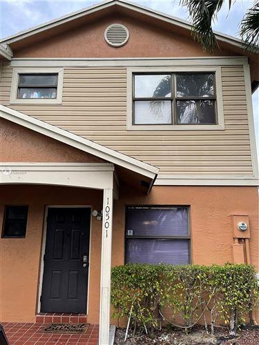 Photo of 10501 NW 8th St #10501, Pembroke Pines, FL 33026 (MLS # A10983924)