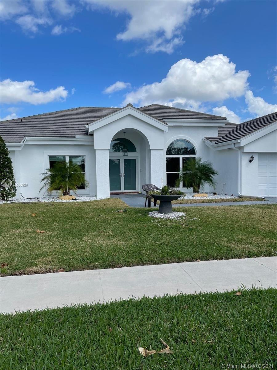 Photo of 11332 SW Clover Leaf Circle, Boca Raton, FL 33428 (MLS # A11005926)