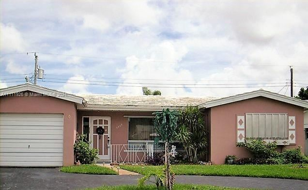 Photo of 3436 NW 33rd St, Lauderdale Lakes, FL 33309 (MLS # A11111926)