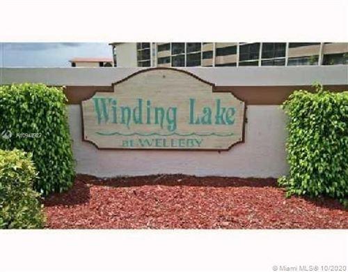 Photo of 10013 Winding Lake Rd #204, Sunrise, FL 33351 (MLS # A10948927)