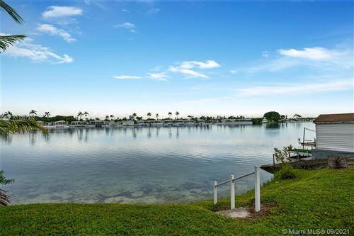 Photo of 217 W Lake Dr, Pembroke Park, FL 33009 (MLS # A11097932)