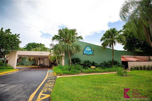 Photo of 9360 Lime Bay Blvd #109, Tamarac, FL 33321 (MLS # A11055935)