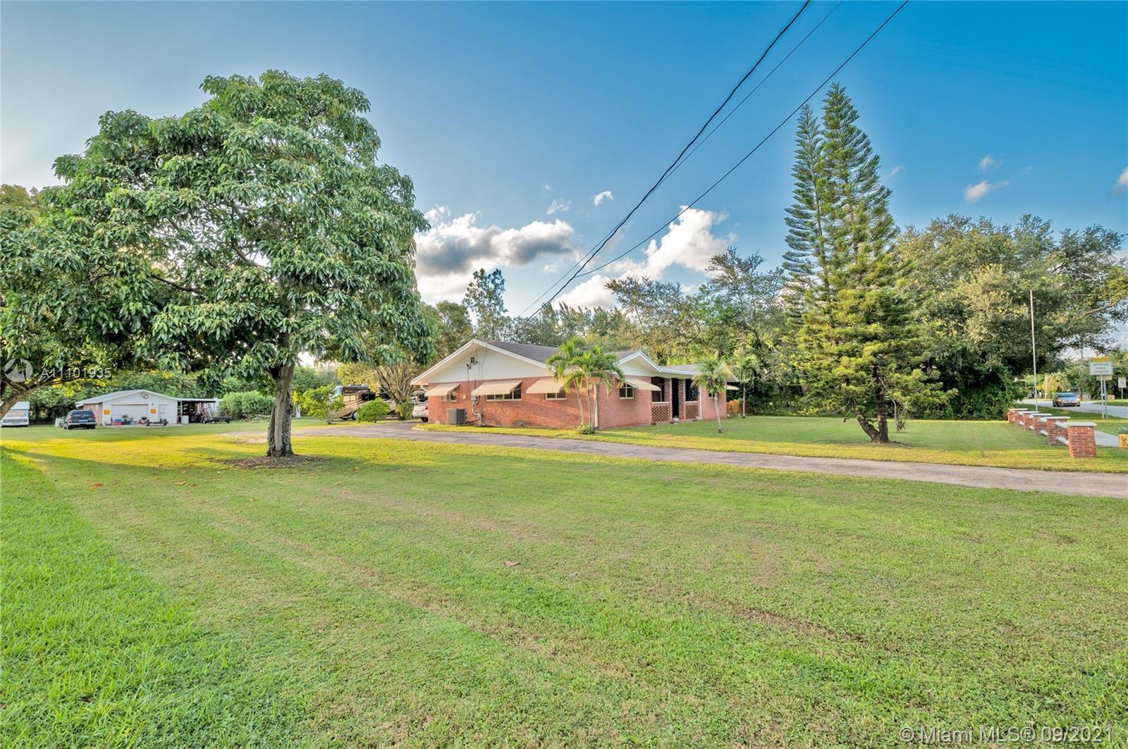 Photo of 4765 SW 61st Ave, Davie, FL 33314 (MLS # A11101935)