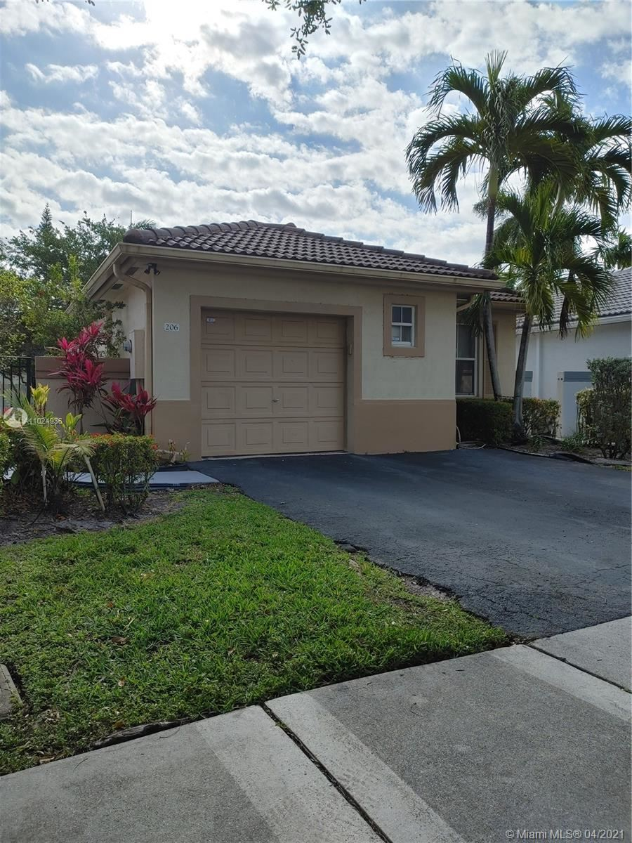 Photo of 206 NW 75th Ter, Plantation, FL 33317 (MLS # A11024936)