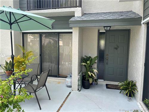 Photo of 3211 Cocoplum Cir #3363, Coconut Creek, FL 33063 (MLS # A11096939)