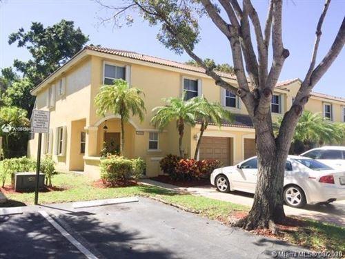 Photo of 16850 SW 1st Mnr #16850, Pembroke Pines, FL 33027 (MLS # A10919941)