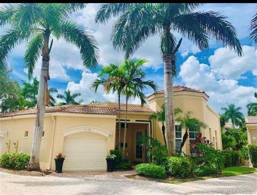 Photo of 7678 Jasmine Ct #105, West Palm Beach, FL 33412 (MLS # A11052941)