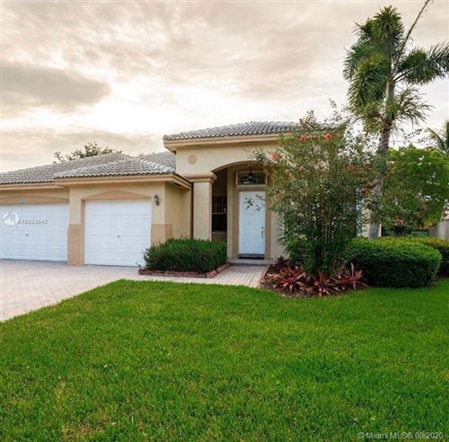 Photo of 998 NW 167th Ter #998, Pembroke Pines, FL 33028 (MLS # A10933942)