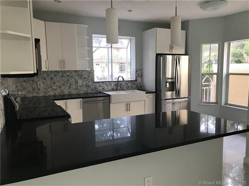 Photo of 1534 Weeping Willow Way #1534, Hollywood, FL 33019 (MLS # A10928945)