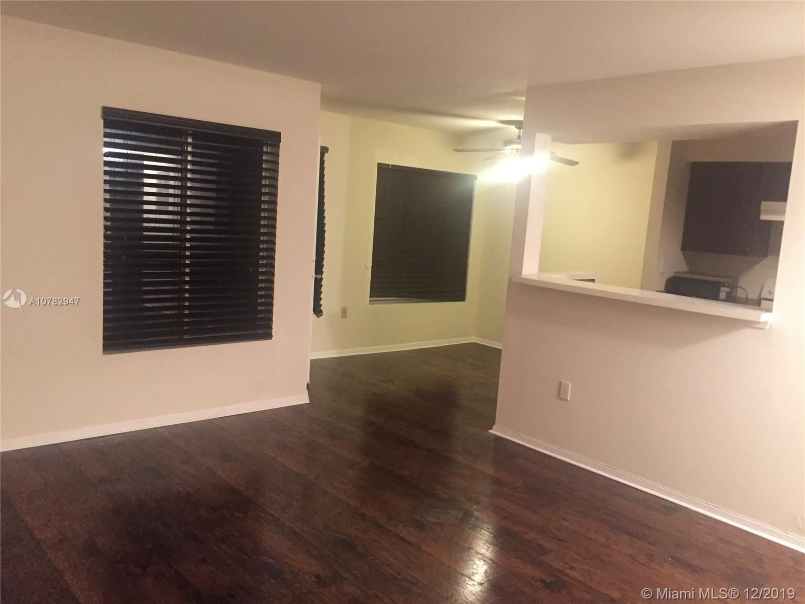 Photo of 2622 NW 33rd St #2011, Oakland Park, FL 33309 (MLS # A10782947)