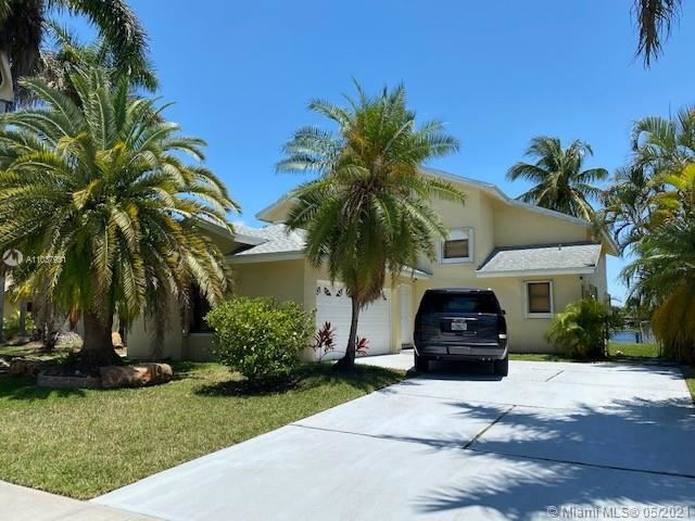 Photo of 311 NW 201st Ave, Pembroke Pines, FL 33029 (MLS # A11037951)