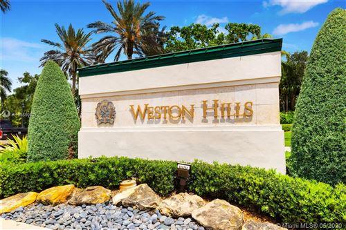 Photo of 2529 Poinciana Drive, Weston, FL 33327 (MLS # A10859952)