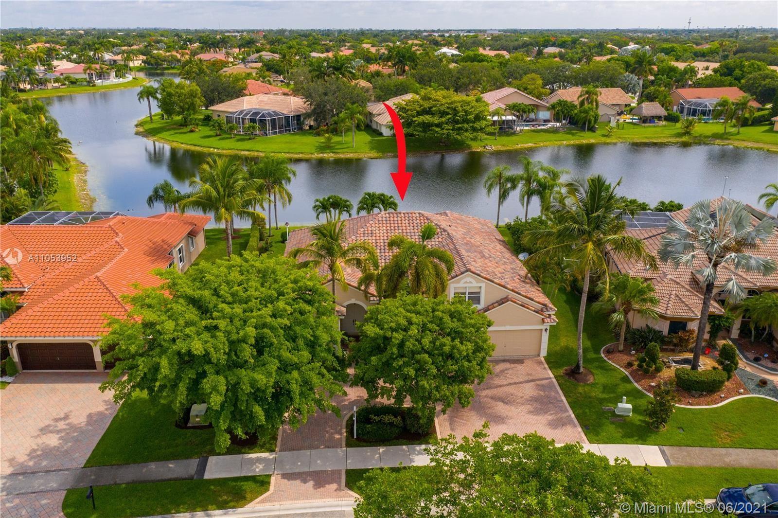 Photo of 5213 Kensington Cir, Coral Springs, FL 33076 (MLS # A11053952)