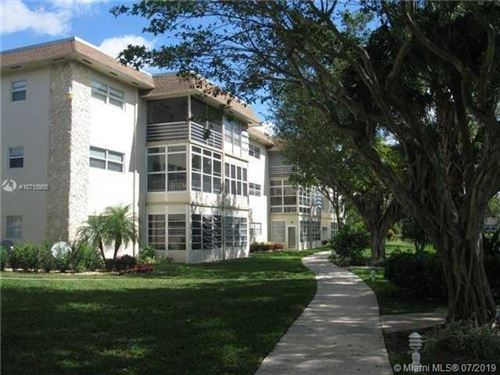 Photo of 5102 NW 36th St #406, Lauderdale Lakes, FL 33319 (MLS # A10710955)