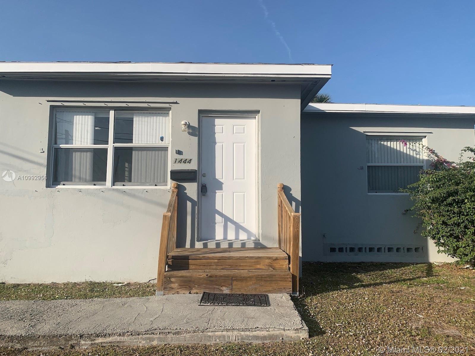 Photo of 1444 W 28th St, Riviera Beach, FL 33404 (MLS # A10992956)