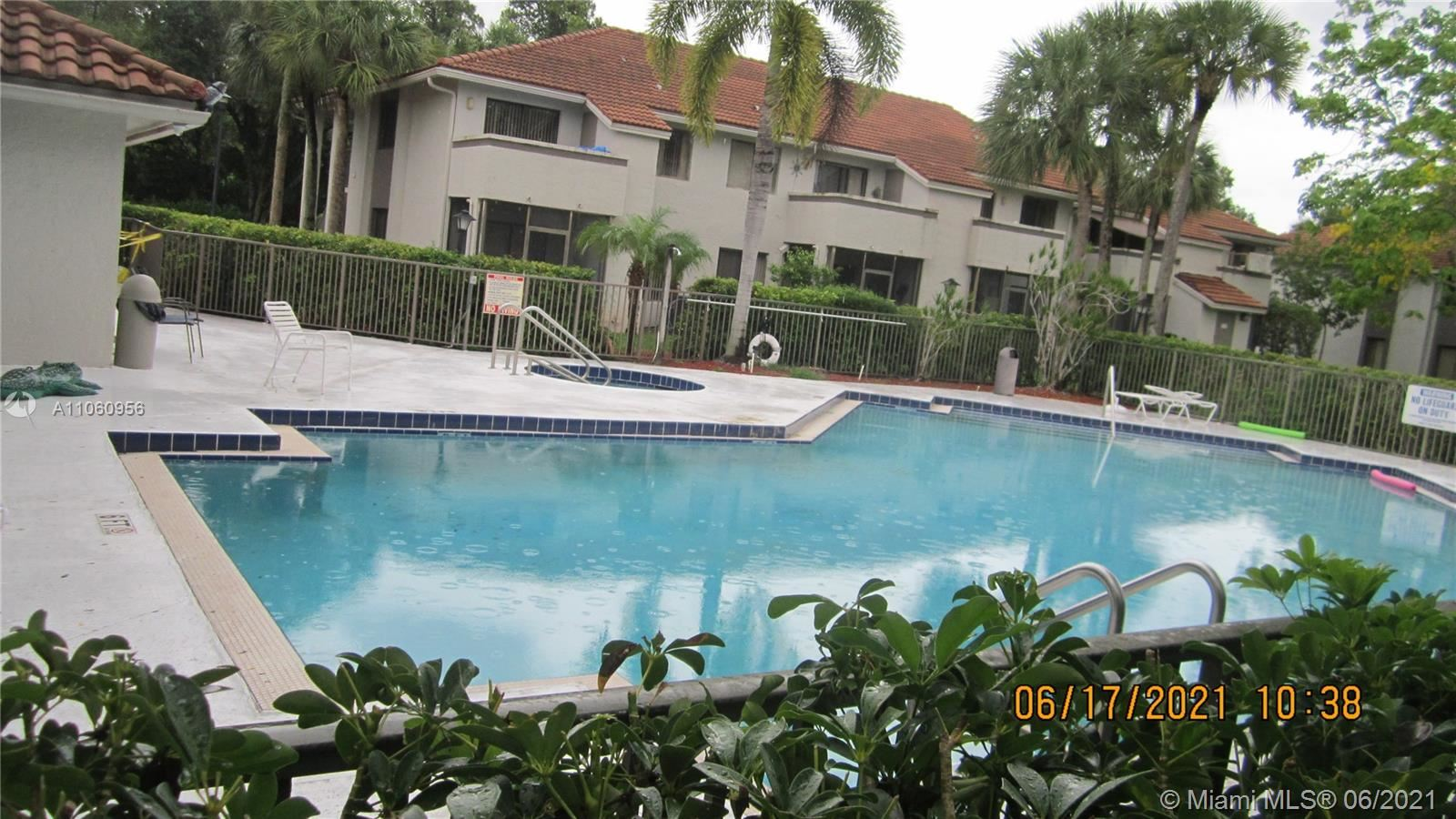 Photo of 3229 Coral Lake Dr #3229, Coral Springs, FL 33065 (MLS # A11060956)
