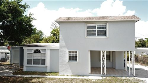 Photo of 1123 NW 15th Ave, Fort Lauderdale, FL 33311 (MLS # A10841957)