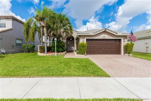 Photo of 1862 NW 145th Ter, Pembroke Pines, FL 33028 (MLS # A11051957)