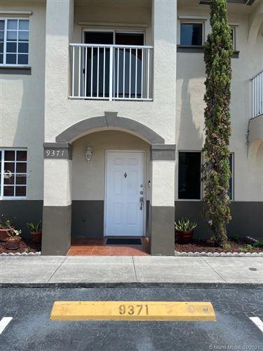 Photo of 9371 NW 114th Ln #3, Hialeah Gardens, FL 33018 (MLS # A11029958)