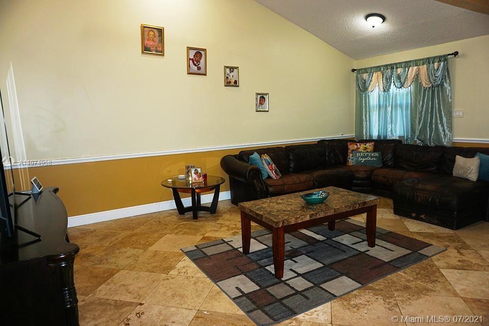 Photo of 300 E Lakewood Cir E #C, Margate, FL 33063 (MLS # A11074958)