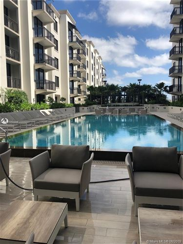 Photo of 301 Altara Ave #307, Coral Gables, FL 33146 (MLS # A10723959)