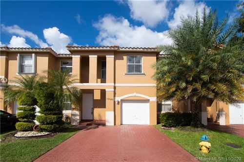 Photo of 13585 NW 9th Ct, Pembroke Pines, FL 33028 (MLS # A10960959)