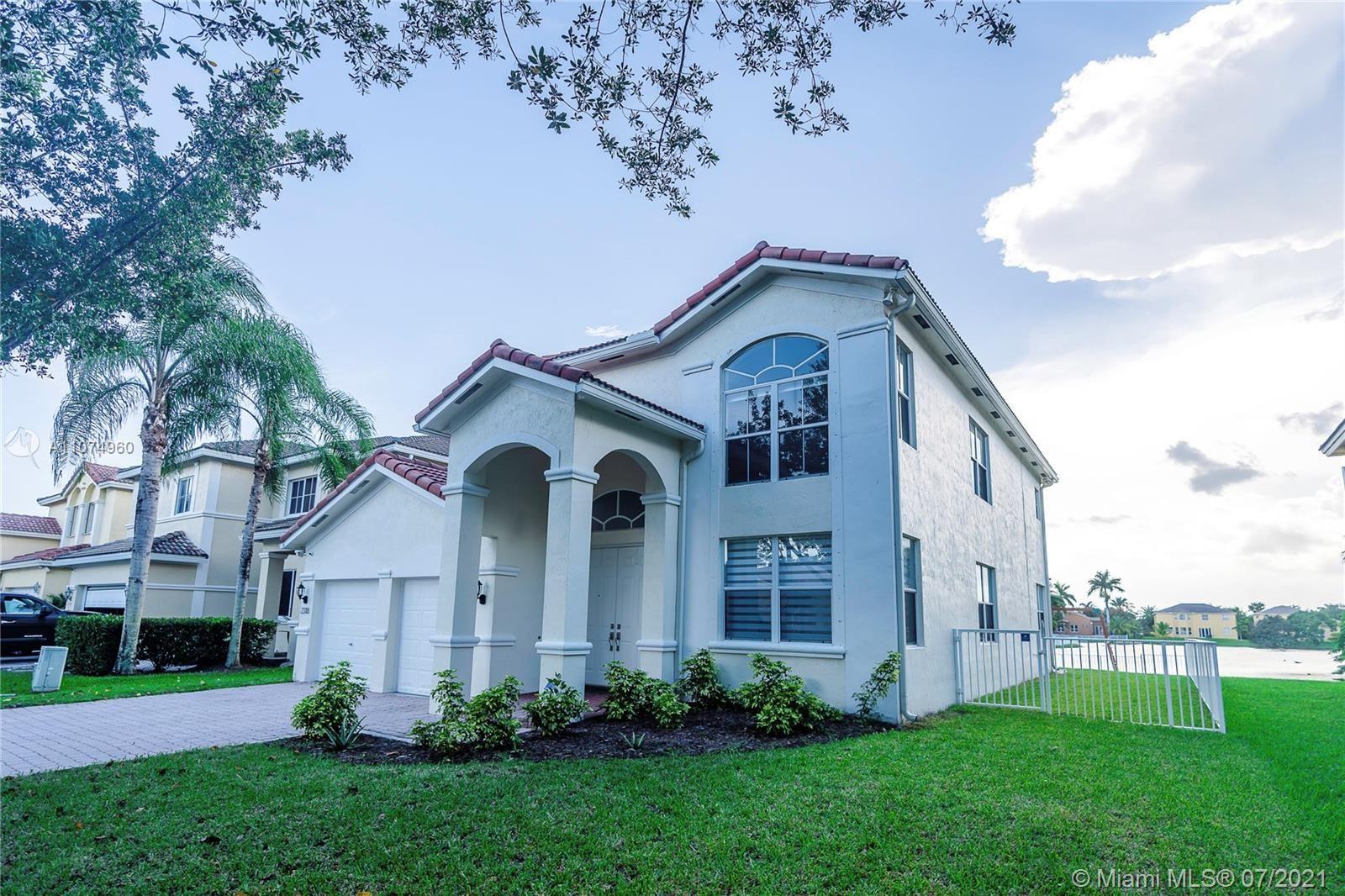 Photo of 2318 SW 127th Ave, Miramar, FL 33027 (MLS # A11074960)