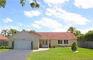 Photo of 11244 NW 43rd Pl, Coral Springs, FL 33065 (MLS # A10656962)