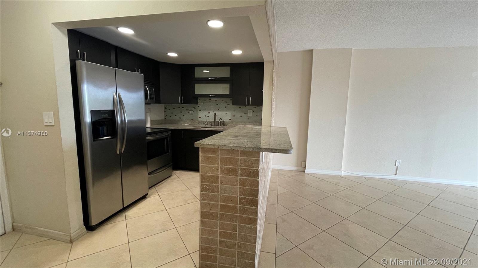Photo of 1465 NE 123rd St #414, North Miami, FL 33161 (MLS # A11074965)