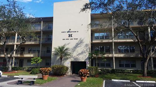 Photo of 13500 SW 1st St #207U, Pembroke Pines, FL 33027 (MLS # A10840966)