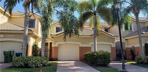 Photo of 4066 Timber Cove Lane, Weston, FL 33332 (MLS # A10960968)