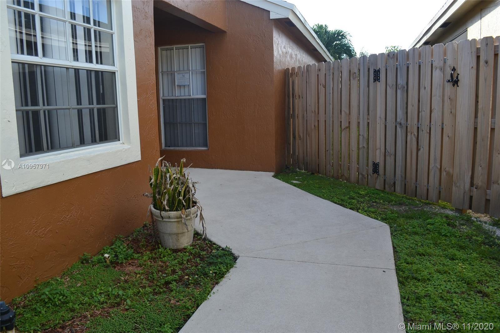 Photo of 227 E Riverbend Dr, Sunrise, FL 33326 (MLS # A10957971)