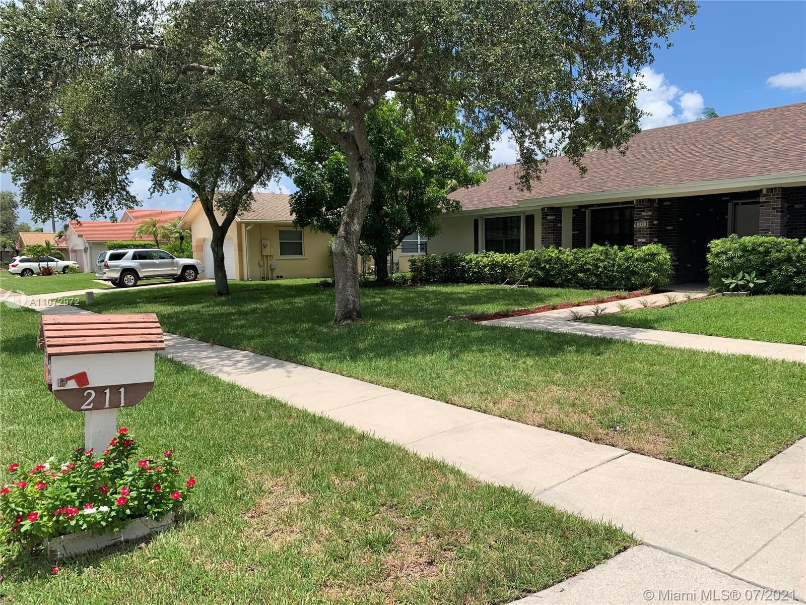Photo of 211 NW 197th Ave, Pembroke Pines, FL 33029 (MLS # A11072972)