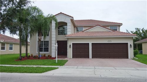 Photo of 1343 NW 139th Ter, Pembroke Pines, FL 33028 (MLS # A10802973)