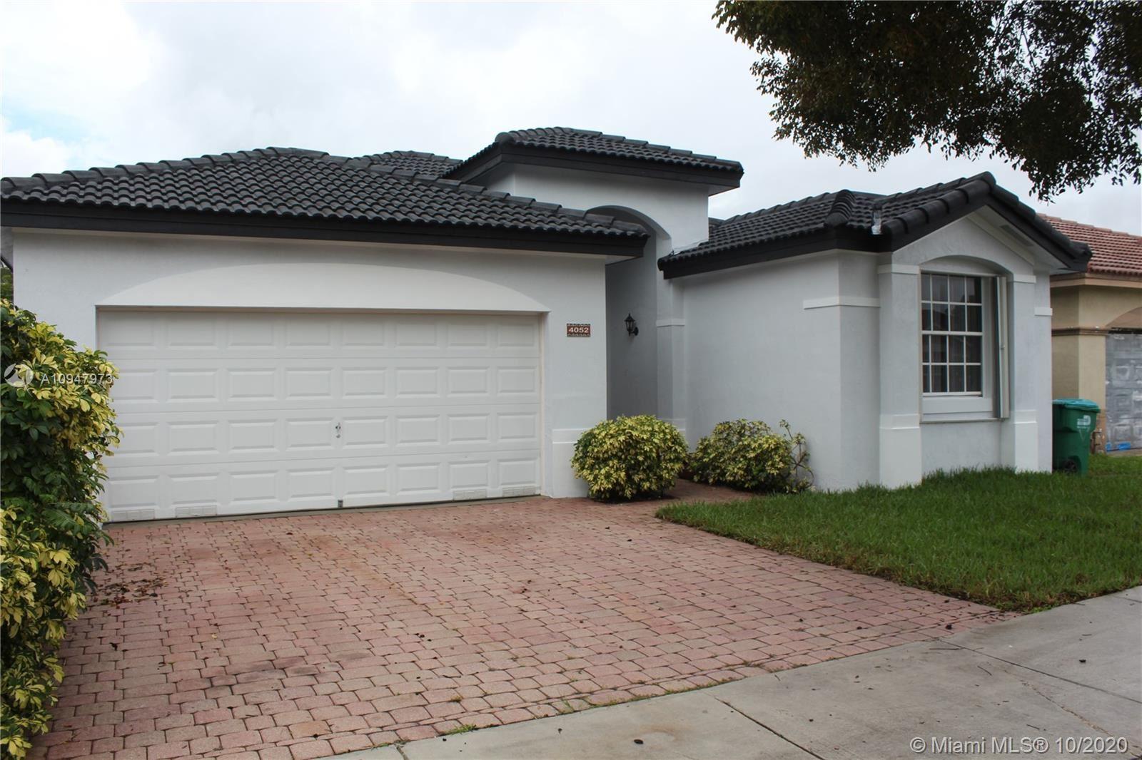 Photo of 4052 SW 154th Ct, Miami, FL 33185 (MLS # A10947973)