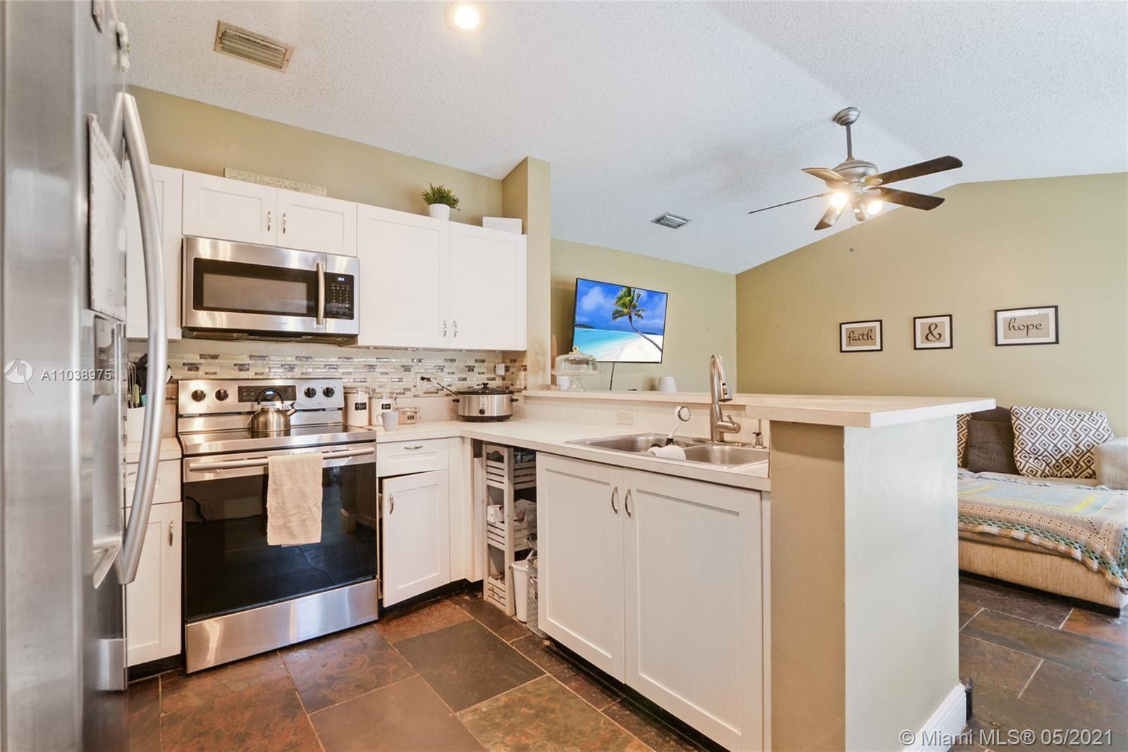 Photo of 10191 SW 9th Ln, Pembroke Pines, FL 33025 (MLS # A11038975)