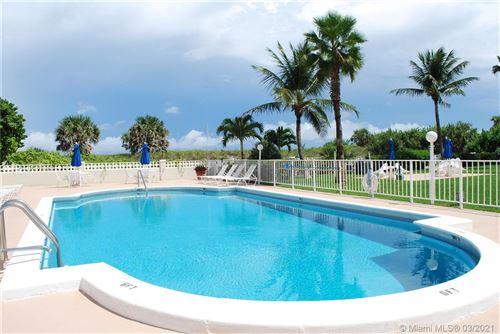 Photo of 125 Ocean Ave #214, Palm Beach Shores, FL 33404 (MLS # A11018977)