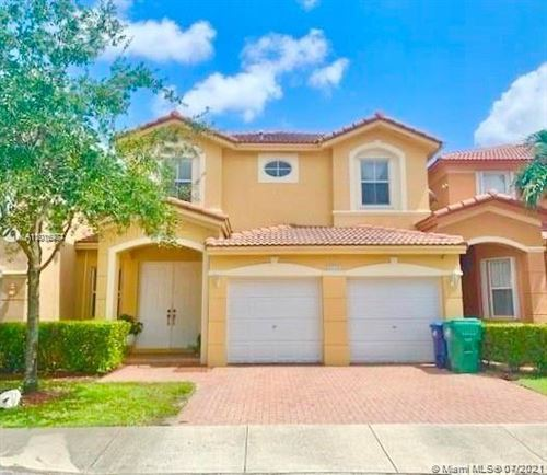 Photo of 8442 NW 114, Doral, FL 33178 (MLS # A11076977)