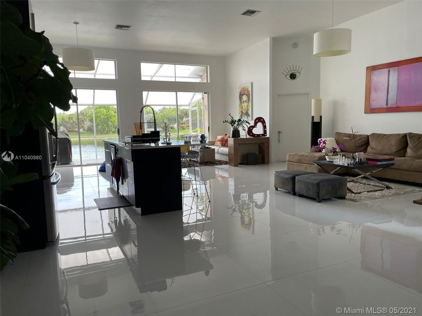 Photo of 14924 SW 15th St, Pembroke Pines, FL 33027 (MLS # A11040980)