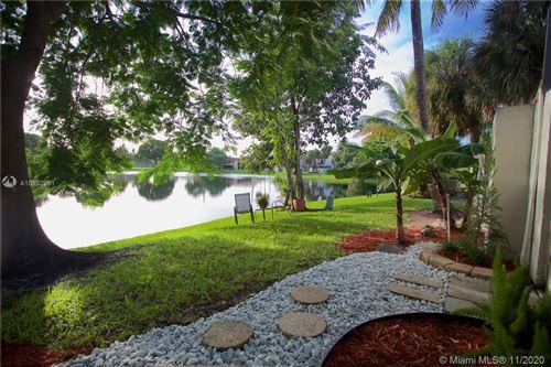 Photo of 1592 NW 90th Way #1592, Pembroke Pines, FL 33024 (MLS # A10932981)