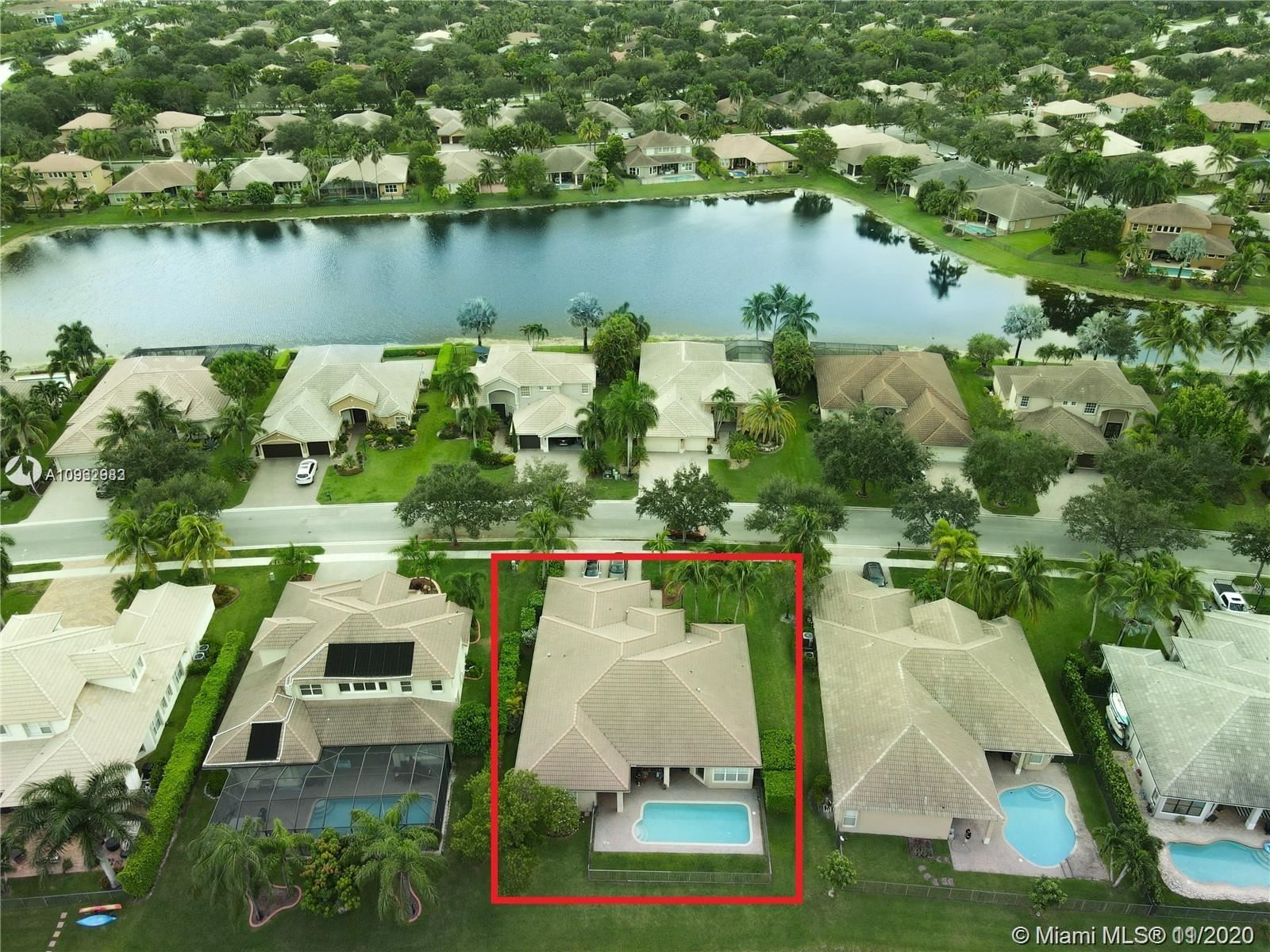 Photo of 6837 NW 110th Way, Parkland, FL 33076 (MLS # A10962983)