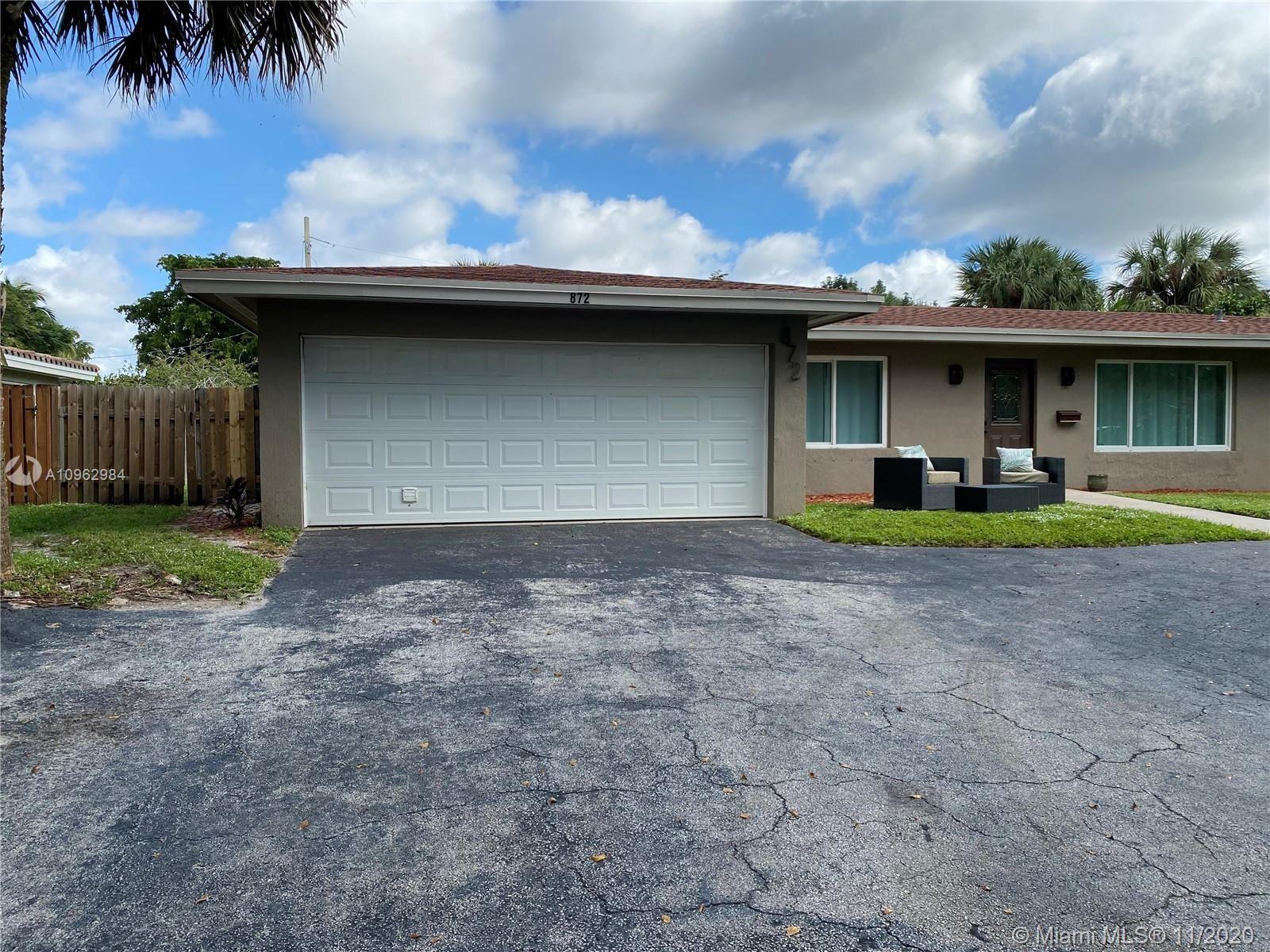 Photo of 872 Garden Ct, Plantation, FL 33317 (MLS # A10962984)